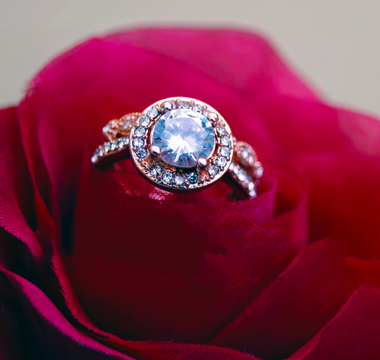 Diamond ring placed on flower