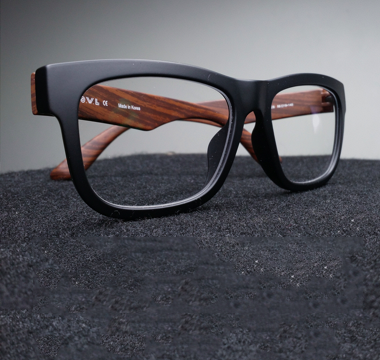 Folded pair of black rimmed glasses