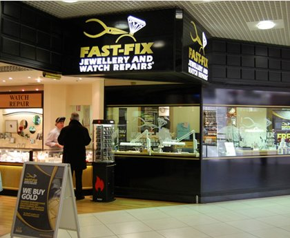 Fast-Fix store front in a mall that shows the front window display