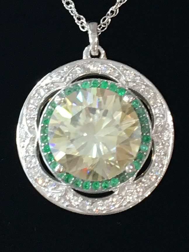 Diamond necklace with emerald halo
